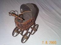 Miniature baby carriage. I was told that this was a