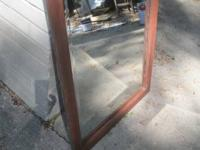 Nice wood-frame mirror with bevel glass. Fluted/carved