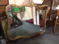 This antique mirror is perfect for a bedroom, bathroom,