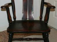 This is an antique chair made of solid oak with a