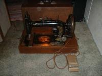 Antique New Home black sewing machine with faded floral