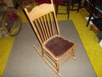 Antique leather bottom baby room chair. Bottom of chair