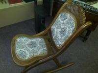 This is a terrific old folding nursing rocking chair.