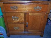 This is a beautiful antique commode dating to the late