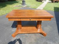For sale here is a antique oak library table with a