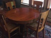 This dining room table is a 45 inch round, oak,