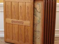 Antique oak map cabinet with 6 maps of continents