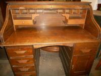 This is an antique roll top desk made from solid oak!