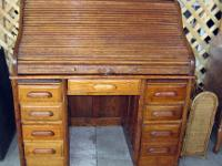 This is an undated antique Roll Top Oak Desk. This has