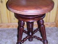 Antique ornate organ (or piano) stool. The seat swivels