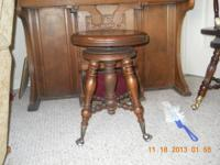 This is an awesome antique piano stool with glass balls