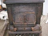 Antique Parlor Stove. Dated 1884. Is stamped by the