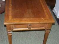 Beautiful antique pecan table, on small wheels with one