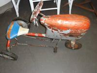 Antique Pedal Tractor. $99.00.  Could be seen at the