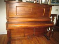 Beautiful mahogany cabinet with ivory keys. This
