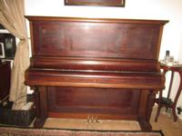 Beautiful 100+ year-old Kimball upright piano for sale.