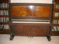 Upright Shultz piano. Needs refinishing. Frame looks to