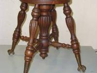 This antique piano or organ stool is in very good