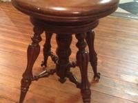 This piano stool is in great condition. Adjustable seat