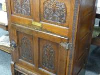 Antique Pilgrim Oak Ice Box unusual having the designs.