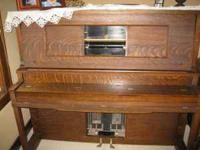 Antique Oak Player piano and bench. Includes Antique