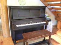 This Wilbur New York piano is from the early 1900s.