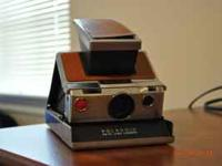 Polaroid 100 land camera in perfect condition looks