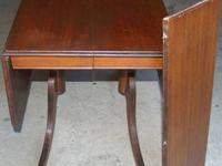 "This is an antique mahogany wood drop leaf table 50"" x"