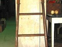This old wooden orchard ladder is tapered from one end