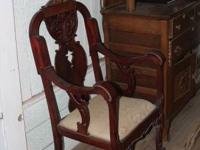 Lion head chair in a cherry finish highlighted with