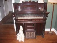 This is a beautiful antique pump organ with a lot of