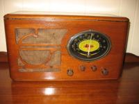 Old farm house radio that runs off a 6 volt battery.