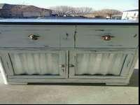 This antique radio cabinet has been completed in a soft