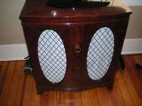 beautiful antique radio that can be used as a TV stand