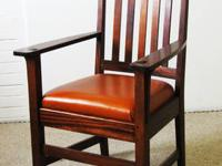 This is an antique, mahogany, Arts & Crafts armchair