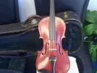 Old red violin, 100 yrs old, lovingly restored, nice