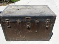 Trunk is dark brown w/brass fittings. Outside needs to