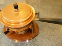 Includes base with brass stand, pan for water, chafing