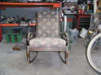 Description Selling an antique rocking chair. In good