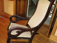 Beautiful antique rocker with carved rosewood frame,