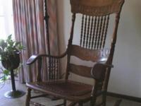 Beautiful and rare antique oak rocking chair with