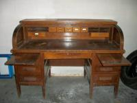 Uncommon oak roll top desk. Big oak roll leading desk.