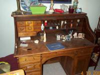 Very nice oak rolltop desk. The desk has some