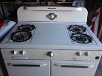 This terrific old gas stove was bought brand name