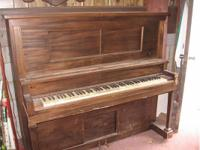 Antique Self Playing Piano with Over 30 Scrolls. Comes