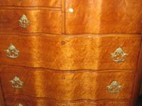 The listing is for this serpentine tall chest of