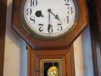 "Antique Sessions key wind wall clock. It's 28"" long and"
