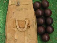 A very old antique Lignum Vitae wood Bocce set and