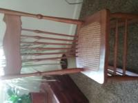 This small chair is a ladies sewing or knitting rocker,