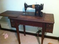Antique sewing machine for sale. Good condition just